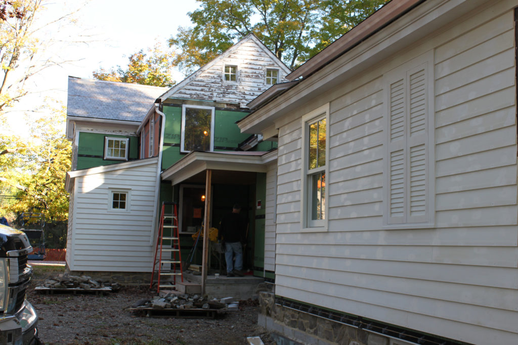 Siding going on new and old sections, windows in