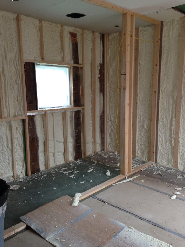 Foam insulation blown into upstairs bedroom